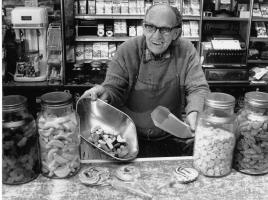 Vic Keary at Keary's Corner Strathfield displaying lollies. Age and origin of photo unknown but estimate age to be mid-1980s.