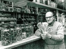 Vic Keary at Keary's Corner displaying lollies