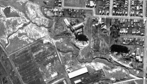 Cooks River Strathfield South c.1947. Showing original river prior to canalling, brickpits, which are now Dunlop Street and Dean Reserve. The road markings are Madeline and Cleaveland Streets.
